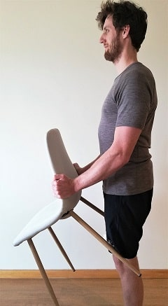 man-carrying-a-chair