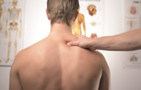 therapist-pressing-myofascial-trigger-point-neck